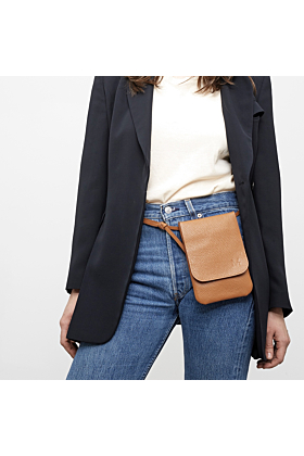 Belt bag orange worn on hips
