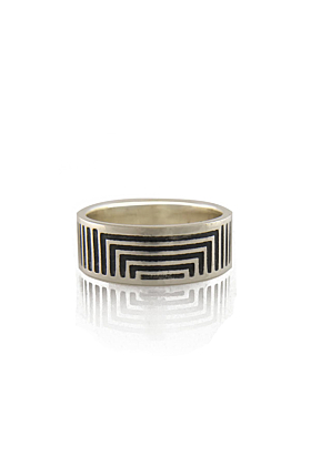 Sideview of an oxidised silver ring with thin lines designed on it